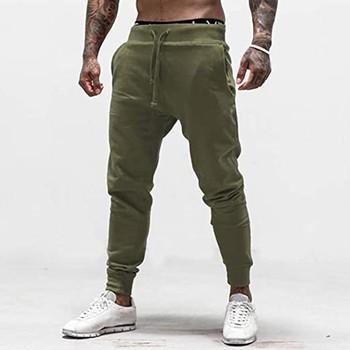 Męska wysokiej jakości marka jakości męskie spodnie Fitness dorywczo elastyczne spodnie odzież sportowa do kulturystyki dorywczo kamuflażu spodnie dresowe spodnie joggery tanie i dobre opinie YOUYEDIAN Ołówek spodnie CN (pochodzenie) Mieszkanie Poliester NONE REGULAR Sweatpants Na co dzień Midweight Suknem Pełnej długości