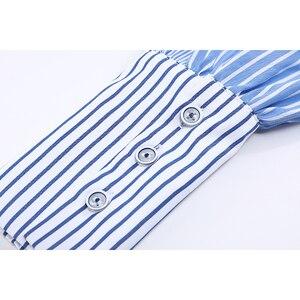 Image 5 - [Eam] Vrouwen Gestreepte Gesplitst Groot Formaat Asymmetrische Blouse Nieuwe Revers Lange Mouwen Loose Fit Shirt Mode Lente Herfst 2020 JZ687