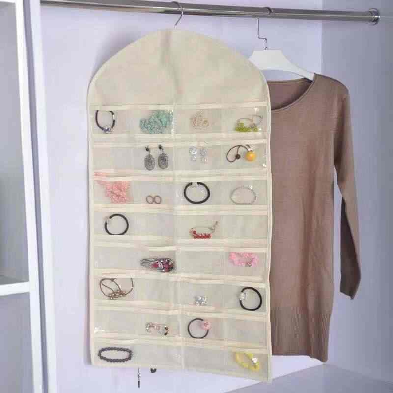 Gran oferta, bolsa colgante de joyería a la moda, collar, pulsera, pendientes, bolsas de exhibición, 32 bolsillos, 18 ganchos, bolsa de joyería, organizador de guardarropa
