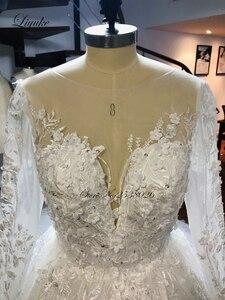 Image 4 - فستان عروس من Liyuke بأكمام طويلة لحفلات الزفاف مع دانتيل رائع من قطار مصلى