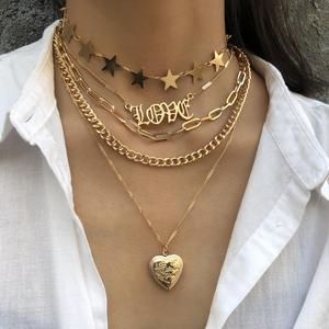KMVEXO Vintage Multi-Layered Love Heart Pendant Choker Necklace Set Boho Golden Stars Long Chain Necklaces Women Christmas Gift