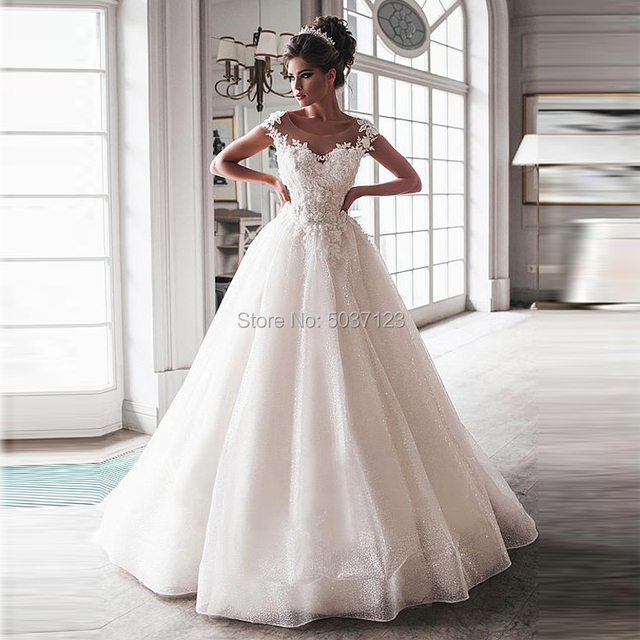 Luxury Bling Ball Gown Wedding Dresses 2021 Nude Tulle Neck Cap Sleeves Lace Applique Corset Buttons Sweep Train Bridal Gowns