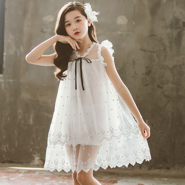 Małe dziewczynki eleganckie sukienki księżniczki letni kostium dla dzieci białe tiulowe oczka puszyste bez rękawów Tutu sukienka dziewczyna odzież Casual nowy