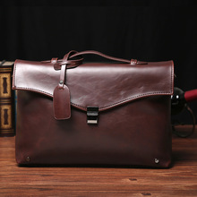 купить Korean version of the new men's handbag business straddle file bag retro trend one-shoulder bag по цене 2873.59 рублей