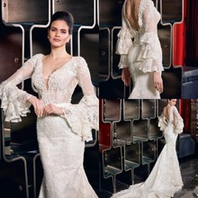 Sexy Backless Bohemian Mermaid Wedding Dresses 2020 Lace Appliques Illusion Long Bell Sleeve V Neck Beach Bridal Gowns