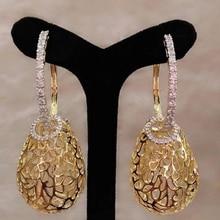 GODKI Роскошные полые капли трендовые длинные серьги кубический циркон Свадебные вечерние индийские Золотые серьги для женщин