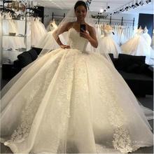Vestido Amanda Design de novia sin tirantes con apliques de encaje, manga larga