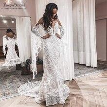 Flare z długim rękawem koronkowe suknie ślubne styl Hippie symfonia suknie ślubne przepuszczalność Sexy Vestido De Noivas DW227