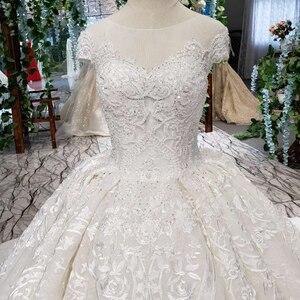 Image 4 - LSS513ヴィンテージのウェディングドレス2020アップリケ結婚式のベールoネックv バックホワイトブライダル夜会服