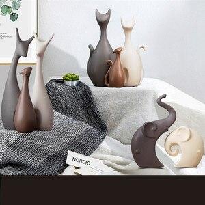 Image 4 - Nordic Table ceramiczne ozdoby porcelanowe zwierzęta dekoracje obejmują słoń kot jeleń królik ślimak wyroby do dekoracji domu miniatury