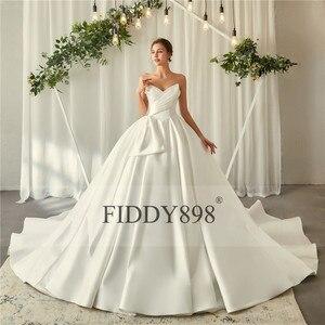 Image 3 - ロイヤルウェディングドレス 2020 V ネックソフトサテンのウェディングドレスふくらん夜会服フリルブライダルガウンロングトレイン Vestido デ noiva