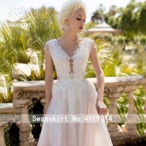Image 3 - Fee V ausschnitt Perlen Hochzeit Kleid Strand Appliques Illusion Tüll A linie Ärmellose Swanskirt D121 Brautkleid Vestido de novia