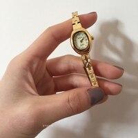 Light luxury small oval dial fine steel golden watch strap retro gold lady watch
