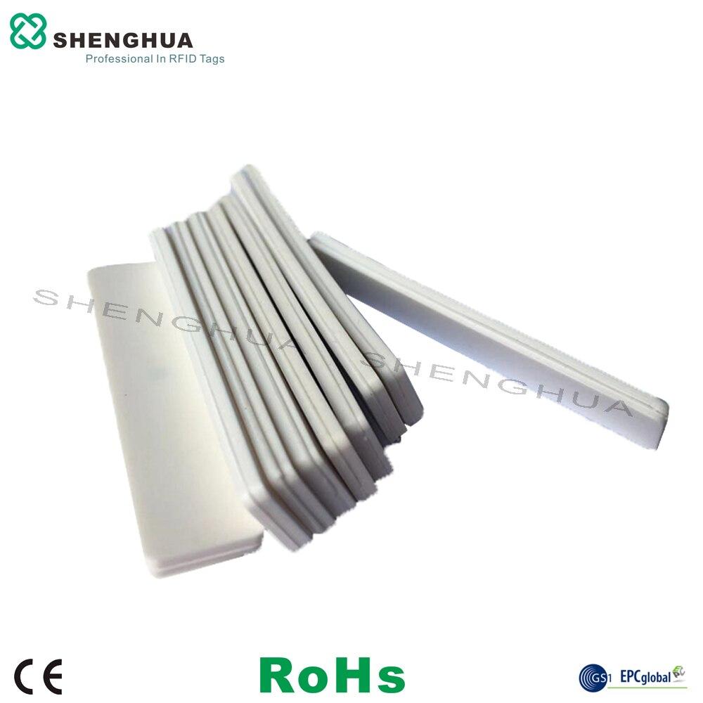 50pcs/pack Wholesale Long Range Soft Washable RFID UHF Tag Flexible White Silicone RFID Laundry Tag Garment Clothing Dry Washing