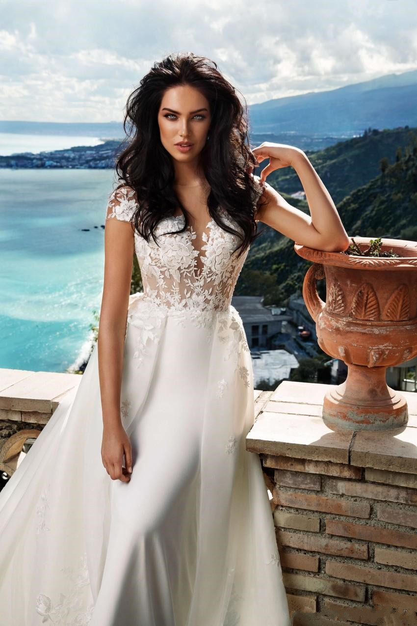 amazing-a-line-lace-overskirt-wedding-dresses-sheer-bateau-neck-backless-bridal-gowns-sweep-train-appliqued-tulle-plus-size-robes-de-mariée (3)
