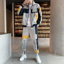 Conjuntos de ropa deportiva para hombres otoño poliéster Moda hombre ciudad impermeable chándal chaqueta Tuta deportiva Uomo chándal Hip Hop h50tz