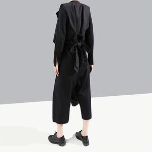 Image 4 - [EAM] pantalones asimétricos negros a rayas con cintura elástica alta, nuevos pantalones holgados ajustados para mujer, tendencia de moda para primavera y otoño 2020 1A933