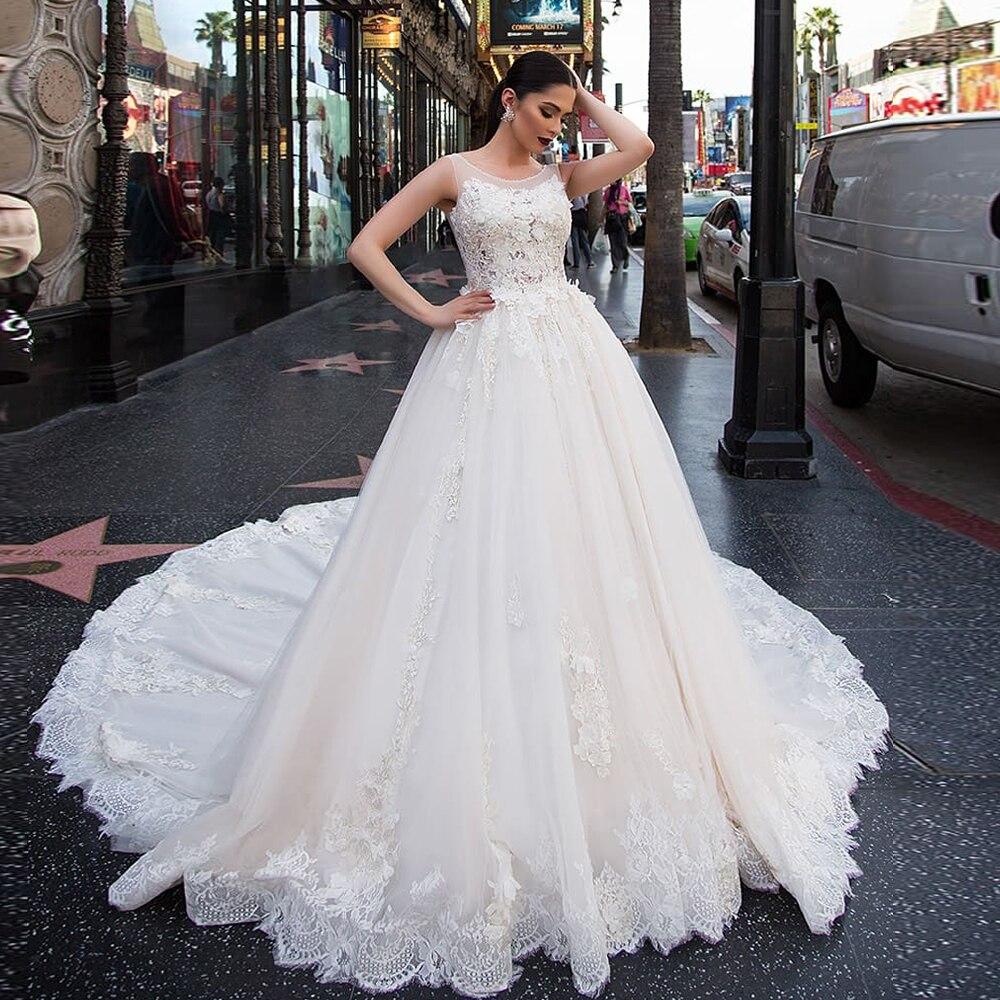 2020 Gorgeous Ball Gown Wedding Dresses With Chapel Train Vestido De Noiva Princesa Beading Lace Appliques Flowers Dress Boda