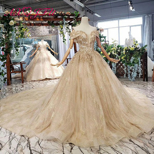 Image 3 - AXJFU Luxury princess golden flower lace boat neck beading crystal sparkly star bride tail wedding dress 100% real photo 11669
