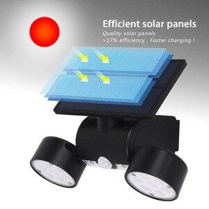Image 3 - Dış duvar lambası güneş LED ışık hareket sensörü duvar işıkları 30 LED IP65 su geçirmez çift ışık kafa veranda garaj hızlı kargo