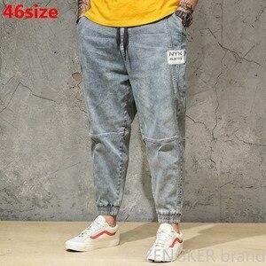 Image 1 - Wiosenny i jesienny kolor światła dżinsy męskie duże rozmiary luźne szarawary japońskie trendy spodnie do kostek spodnie wiązane 46