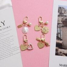 Fashion Shell Pearl Keychain Heart Pendant Keyring Creative Ocean Series Pendant Keyring Jewelry Accessories Girl Keyring keyring buck model pendant decor