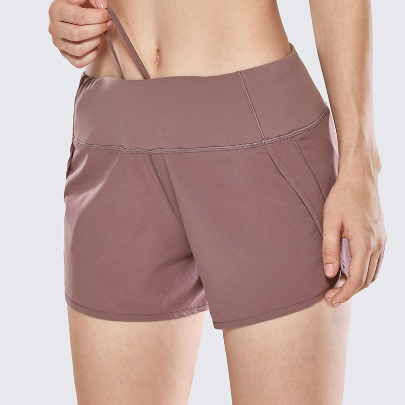 4 Inches CRZ YOGA Womens Athletic Workout Sports Running Shorts with Zip Pocket