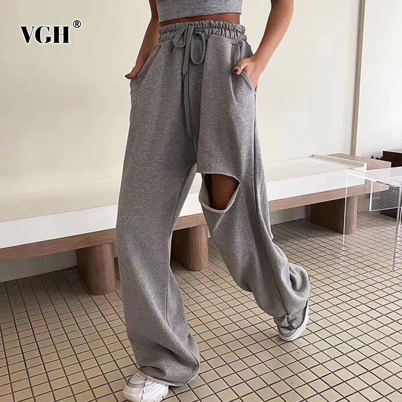 VGH Casual Loose Sweatpants Women High Waist Lace Up Ripped Hole Asymmetrical Sweat Pants For Female Fashion Clothing Summer New