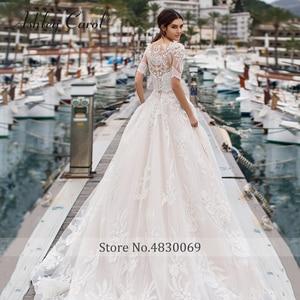 Image 2 - אשלי קרול קו שמלות כלה עם מעיל 2020 Vestido דה Noiva חוף חצי שרוול אפליקציות תחרה עד כפתור כלה שמלות