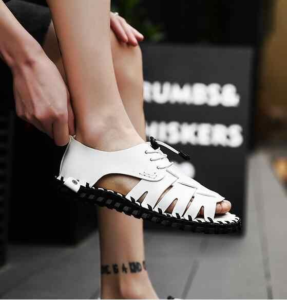 Erkek seksi maruz ayak balık ağzı sandalet avrupa ve amerika birleşik devletleri rüzgar kayış delik ayakkabı tüm siyah elastik sandalet
