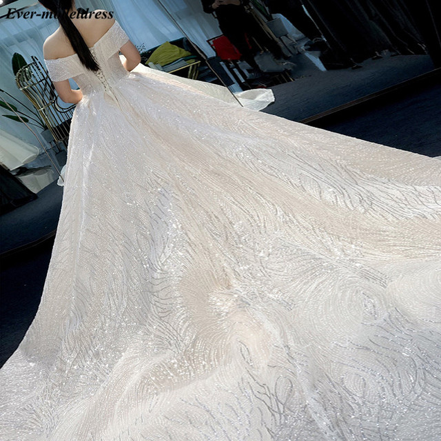 Luxury Wedding Dresses 2021 Off Shoulder African Sparkly V-Neck Lace Up Back Ball Gown Court Train Bridal Robe Do Mariee 2