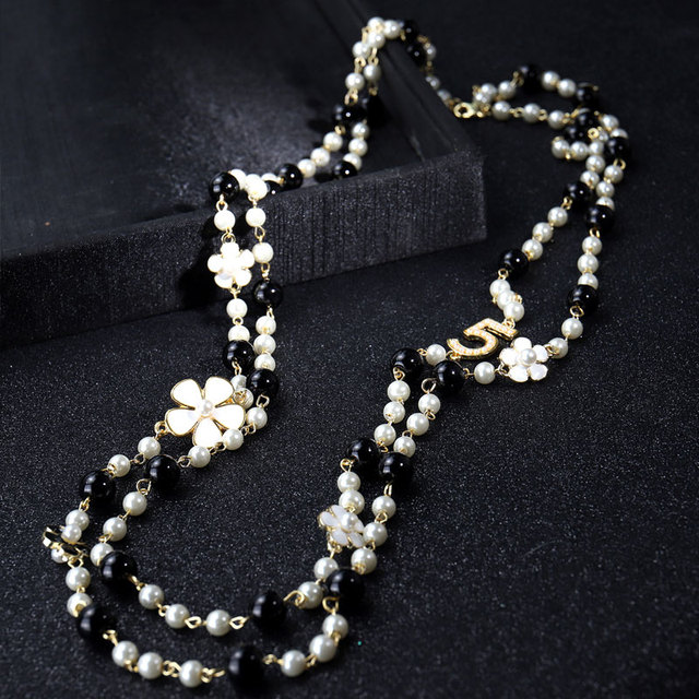 layered pearl and number pendant necklace 4