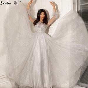 Image 1 - 穏やかなヒルグレー a ラインビーズ羽デザインのイブニングドレス 2020 ドバイ長袖高級フォーマルなパーティーの摩耗ガウン CLA70472