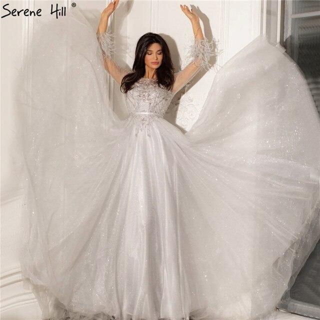 穏やかなヒルグレー a ラインビーズ羽デザインのイブニングドレス 2020 ドバイ長袖高級フォーマルなパーティーの摩耗ガウン CLA70472