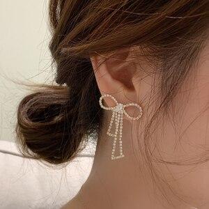 AMORCOME New Full Rhinestone Bow Tassel Drop Earrings Crystal Bowknot Earrings for Women Fashion Jewelry Wedding Brincos Bijoux