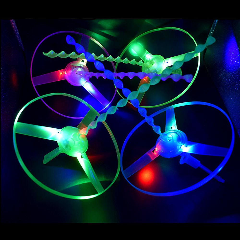 Hot Sale Glow In The Dark Flashing Toys Funny Pull String UFO LED Light Up Flying Disc Colorful Kids Toys For Children @A