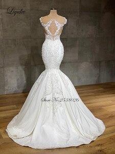 Image 2 - Liyuke 2020 projektant syrenka suknia ślubna prawdziwa praca całe z koralików suknia ślubna makijaż