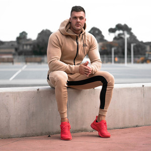 Image 1 - Sportswear Tracksuits Men Sets Running Gym Tracksuit Fitness Body building Mens Hoodies+Pants Jogger Sport Suit Men Clothing