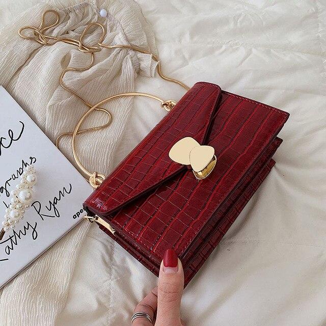 Sacs à bandoulière en cuir d'unité centrale de modèle de pierre pour des femmes 2020 Mini sac de messager d'épaule avec la poignée en métal fourre-tout de voyage de dame 1