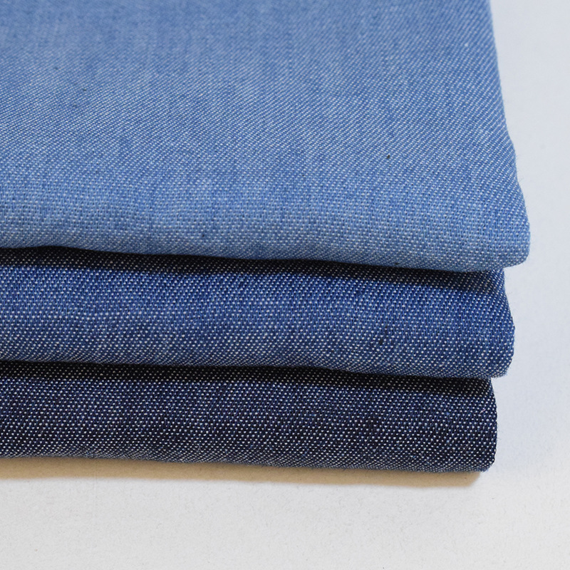 Plain woven denim fabric suppliers 35% polyester 65% cotton washed for jeans coat