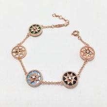 Verkäufe von high-end-hand handeln die rolle von mode vermögen kompass achteckige kupfer shell armband farbe mehr