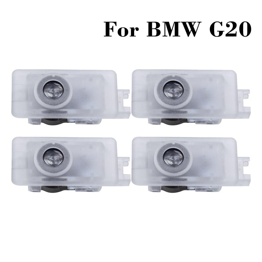 LED araba kapı nezaket karşılama lambası BMW G20 G21 2020 G02 G07 G29 Z4 X7 M8 M4 3 8 serisi araba logosu lazer projektör hayalet ışık