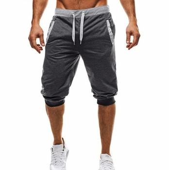 Letnie męskie spodnie dresowe na co dzień spodenki 1 2 spodnie krótkie odzież Fitness kulturystyka męskie spodenki miękkie spodnie bawełniane spodenki XXXL tanie i dobre opinie Proste Mieszkanie Poliester COTTON NONE REGULAR 66 - 78 Pełnej długości chunse Midweight Suknem Cielę długości spodnie