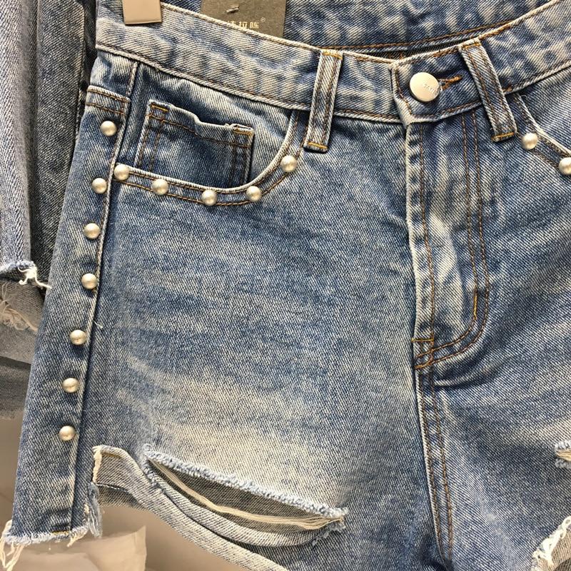 INS Super Fire Denim Shorts Women's Light Color High-waisted A- Line Irregular Loose Pants Rivet Slimming Flash Hot Pants Summer