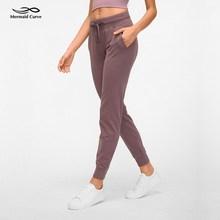 Mermaid eğrisi rahat serin Jogger pantolon koşu pantolon Drawcord kemer Yoga pantolon yüksek bel gevşek Fitness pantolonları kadın