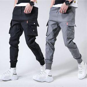Image 1 - Erkek yan cepler Harem pantolon 2020 sonbahar Hip Hop rahat şerit tasarım erkek Joggers pantolon moda Streetwear pantolon siyah