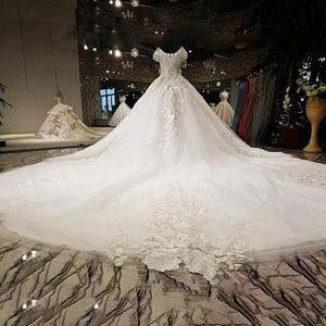 Image 2 - LS59840 see through scoop neck 2018 new design satin cap sleeve big heavy skirt super long train corset back wedding dress