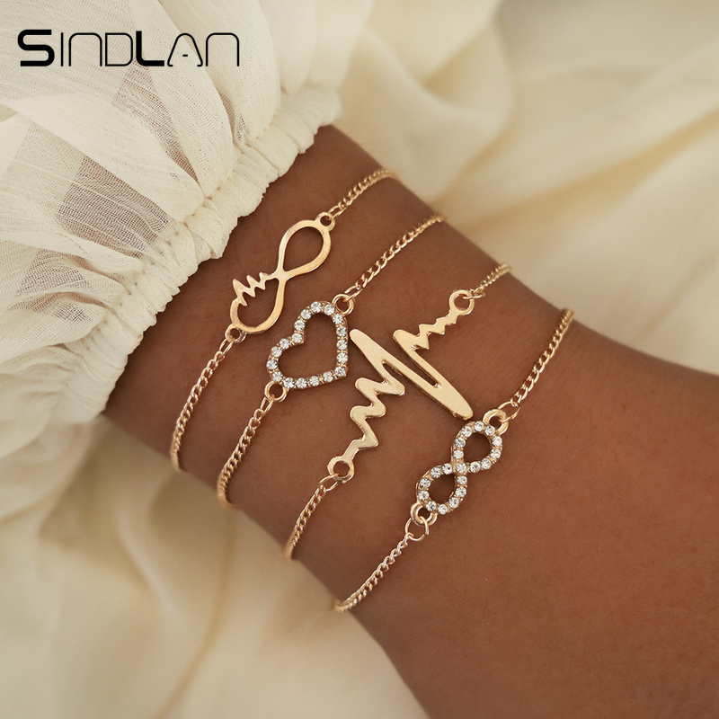 Sindlan 4PCs Crystal Heart Infinity Bracelets for Women Gold Heartbeat Charm Wrist Chain Set Kpop Fashion Hand Jewelry Pulsera