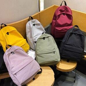Image 3 - HOCODO katı tuval gençler için sırt çantası kadın rahat büyük kapasiteli okul çantası basit kolej rüzgar seyahat sırt çantası Mochila