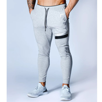 Bawełniane spodnie dresowe dopasowane obcisłe spodnie kulturystyka spodnie nowe męskie spodnie sportowe spodnie dresowe spodnie dresowe spodnie gimnastyczne męskie biegaczy tanie i dobre opinie DFKDZG Wiosna i jesień CN (pochodzenie) COTTON CASUAL Na co dzień Mieszkanie Z elementami naszywanymi REGULAR Pełna długość